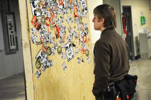 Rabbit checks out the sticker wall...